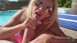 Beautiful girl gives risky blowjob in public around the pool