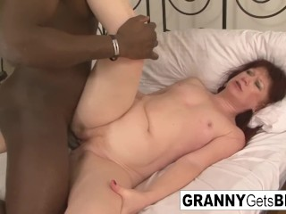 Euro granny redhead teases the camera and the big black cock esmeralda
