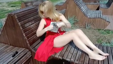 A spy in the park on a gorgeous hottie  in red, mmm strings go aside...