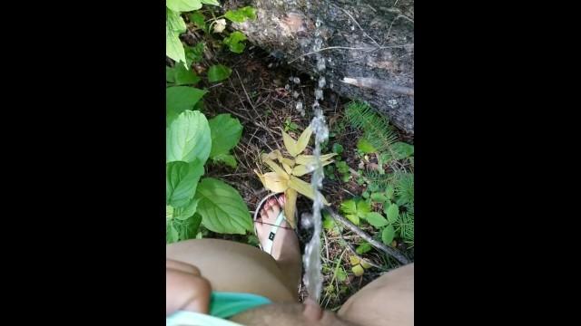Asian girls in swin suit Girl in swim suit pees on fallen tree by river