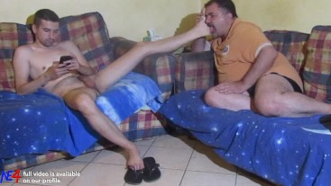 fetish on sofa... young master gets his feet licked by the slave p