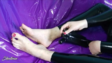 Putting on latex rubber toe socks