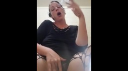 Smoking goth chick playing in fishnets