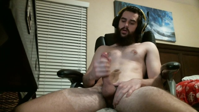 Jerking to porn Hot gamer guy cums on himself jerking to porn