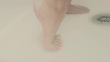 Washing Her Feet in Shower