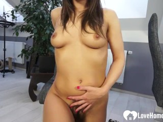 Busty brunette shows her very hairy pussy