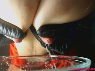 Mom milking her fat milk in a bowl for you