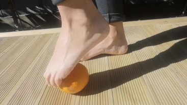 Orange Squishing with her Sexy Feet