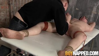 Restrained and blindfolded twink gets his large cock sucked