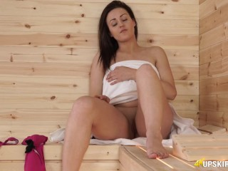 Young Babe In Sauna With Her Pussy Showing For You To Have A Cheeky Wank