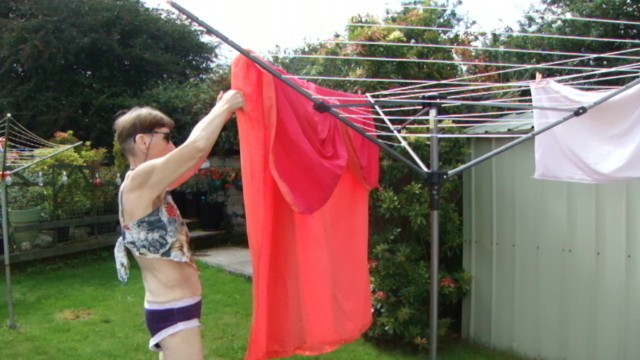 Sexy housewife movies Hanging washing outside in sexy outfit purple knickers, nice top sexy legs