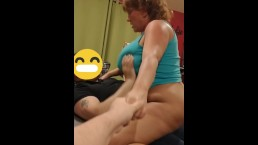 Romantic wife holds hubby's hand while riding friend