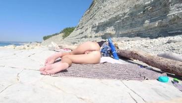 Naked girl on the beach. Naked girl on the beach masturbates.