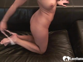 Brunette fingers herself while laying on the couch