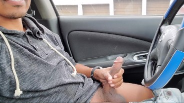 Public masturbation getting my cock hard while traffic passes by