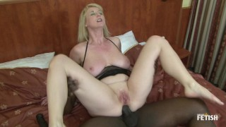Busty MILF gets her shaved pussy drilled by big black cock