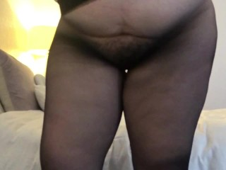 Busty BBW Babe Puts on Sheer Black Pantyhose in Slow Motion