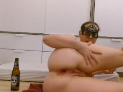 Norwegian Milf amateur plays with beer bottle