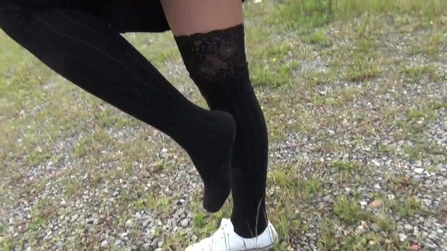 Black up skirt sex Schoolgirl in black knee socks and white shoes show under the skirt