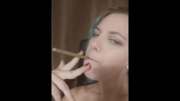 Smokes a little cigar, watch the ash burn down