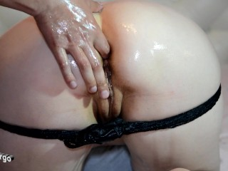 Watering a fucking bitch with oil fucking in the ass with fingers and cum