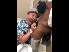 Asian tourist sucked a big black cock at the airport toilet