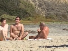 3 buddies jerking off each other at the beach.