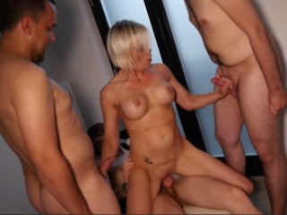 Mature Blonde Big Tit Milf in a Gangbang with Three Big Dicks Fucking her