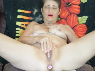 Masturbating with my nipple chain and my butt plug. This is a wet one.