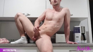 guy jerking off his meat with big cumshot in the kitchen