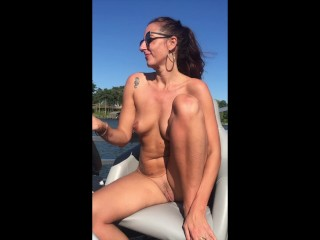 Naked Boat Captain, MILF takes it all off on the water.