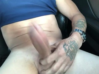 Dude beating a big dick in his car came all over his stomach