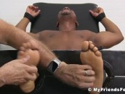 Ebony hunk Rolly restrained for foot fetish domination