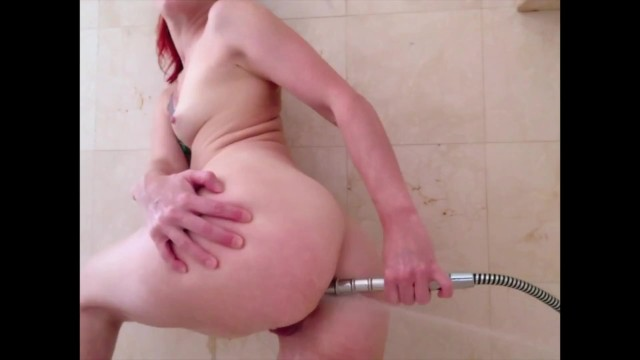 Redhead enemas Redhead cleans her ass with a shower enema