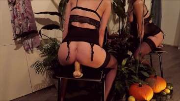 Sexy witch in lingerie rides a huge 9.5 inch dildo for halloween