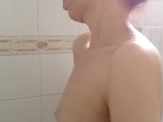 close up down up view of girls sexy huge adams apple in the shower