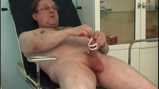 Kinky chubby doctor masturbates using medical instruments