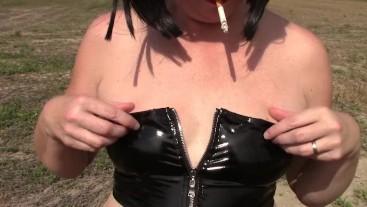 Smoking in leather leggings
