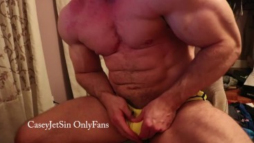 Onlyfans model - muscle hunk teasing in tight yellow briefs in chair