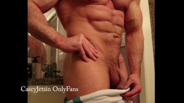 Fitness model teasing flexing with cock out