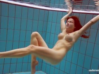 Sexy brunette Deniska underwater