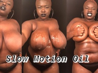 Slow motion BBW rubbing oil on big natural tits body