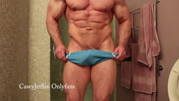 Slow motion muscle flexing in skin tight blue booty trunks onlyfans