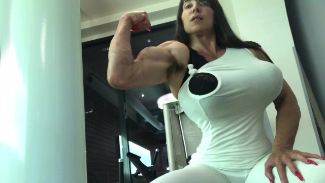 Mature female bicep - Huge biceps...and boobs... and booty