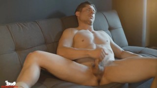 Rocky strokes his balls and his thick cock begins plumping