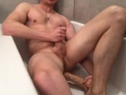 Muscular guy is pissing, fucking himself with dild, moaning, and cums