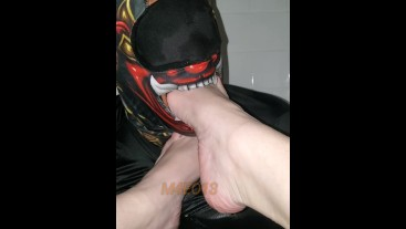 Bossy babe foot dominates and hand gags a masked creep