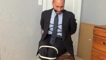 Chairtied in a Suit