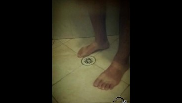 Soapy shower feet and rubbing one down - peephole view