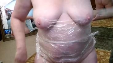 V 332 Mature Sexpot DawnSkye strips and wraps self in plastic